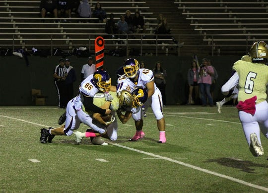 Wylie defenders Halden Ross (86), Brodey Baker (88) and Dayton Barnes (47) combine to bring down Wichita Falls Rider's Noah Randall (16) during Friday's 34-7 loss.