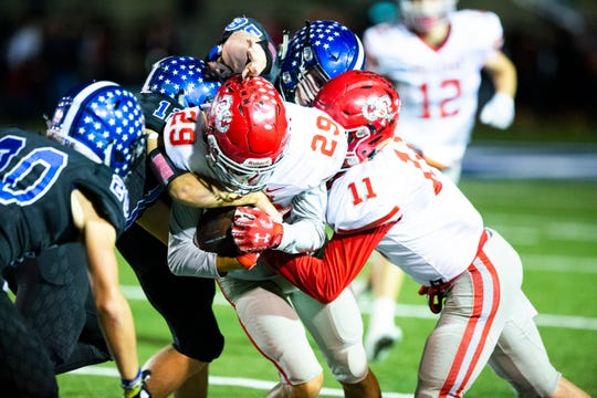 Holliday's Sebastian Perez gets tackled Friday night in a district game at Gunter.