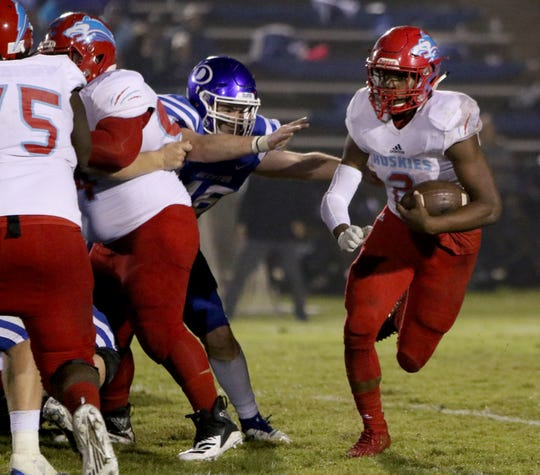 Hirschi's Fred Fleeks runs around the line of scrimmage in the game against Decatur Friday, Oct. 12, 2018, at Eagle Stadium in Decatur. The Eagles defeated the Huskies in a 22-21 upset.