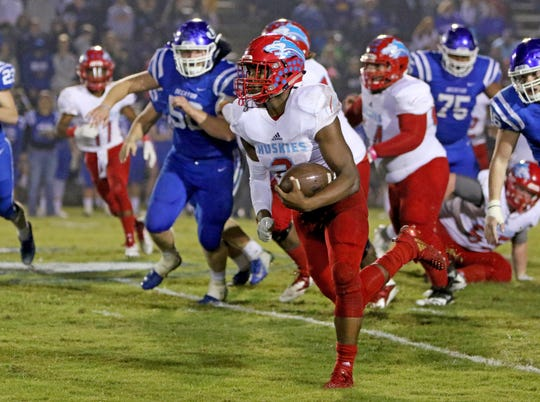 Hirschi's Fred Fleeks runs for a large gain against Decatur Friday, Oct. 12, 2018, at Eagle Stadium in Decatur.