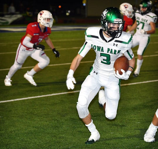 Iowa Park junior Slayton Ochoa (3) carries the ball against Graham Friday night at Newton Field in Graham. The Steers defeated the Hawks, 42-14.