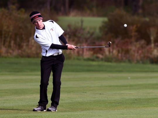 Owen Carney, of Crooksville, pitches on to the 16th green during the first round of the 2018 Division III state golf tournament at North Star Golf Club. Carney, who shot 87, is part of a Ceramics team making their second straight state appearance.