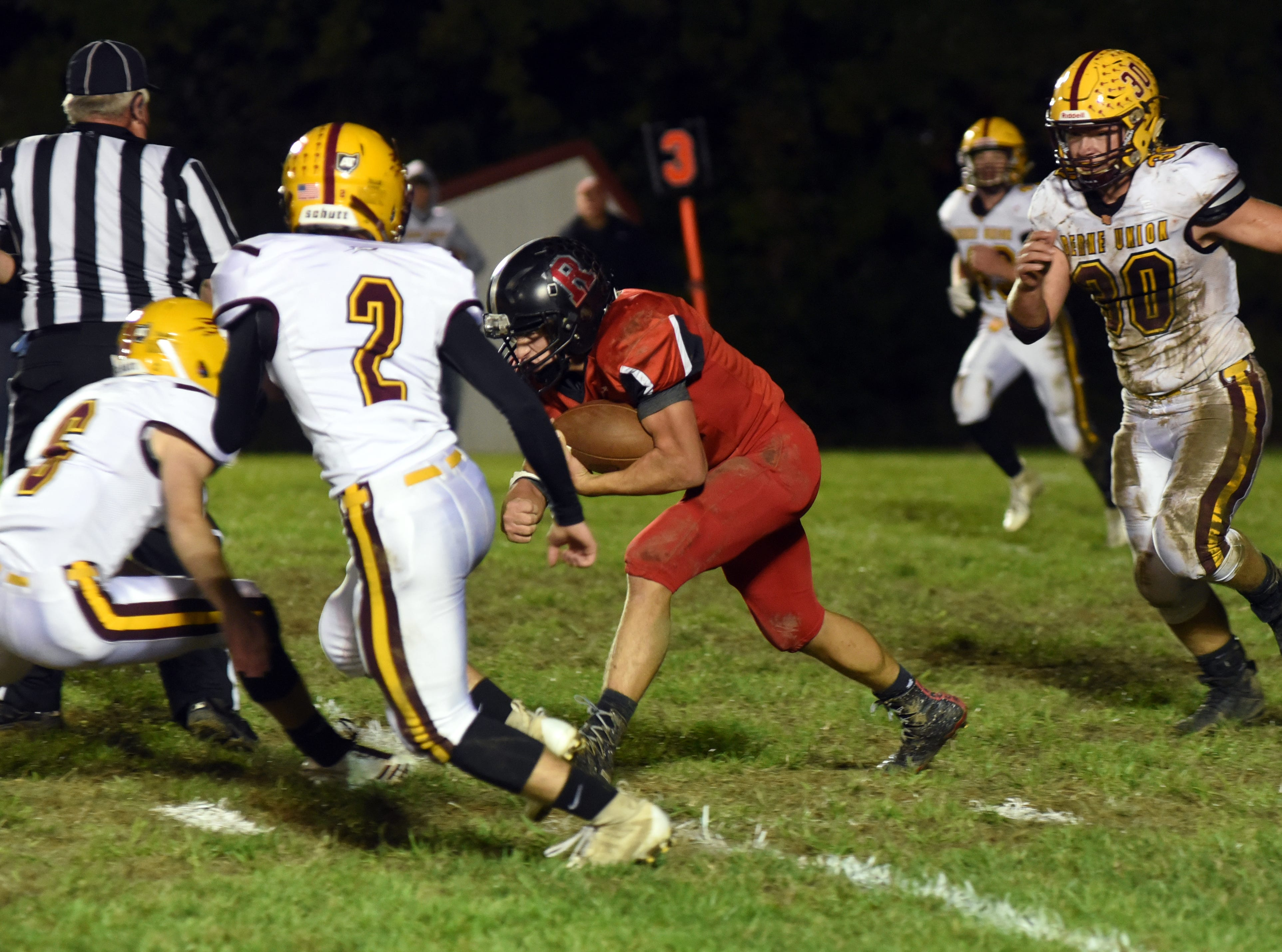 Rosecrans' Austin Church takes on Berne Union's Chase McCartney (6) with Landon Godenschwager (2) helping in Berne Union's 41-14 win on Friday.