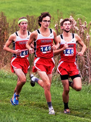 Sheridan's Brandon Lanning, left, William Wilke and Mitchell Wells compete in the Muskingum Valley League Cross Country Meet on Saturday at Foxfire High School.