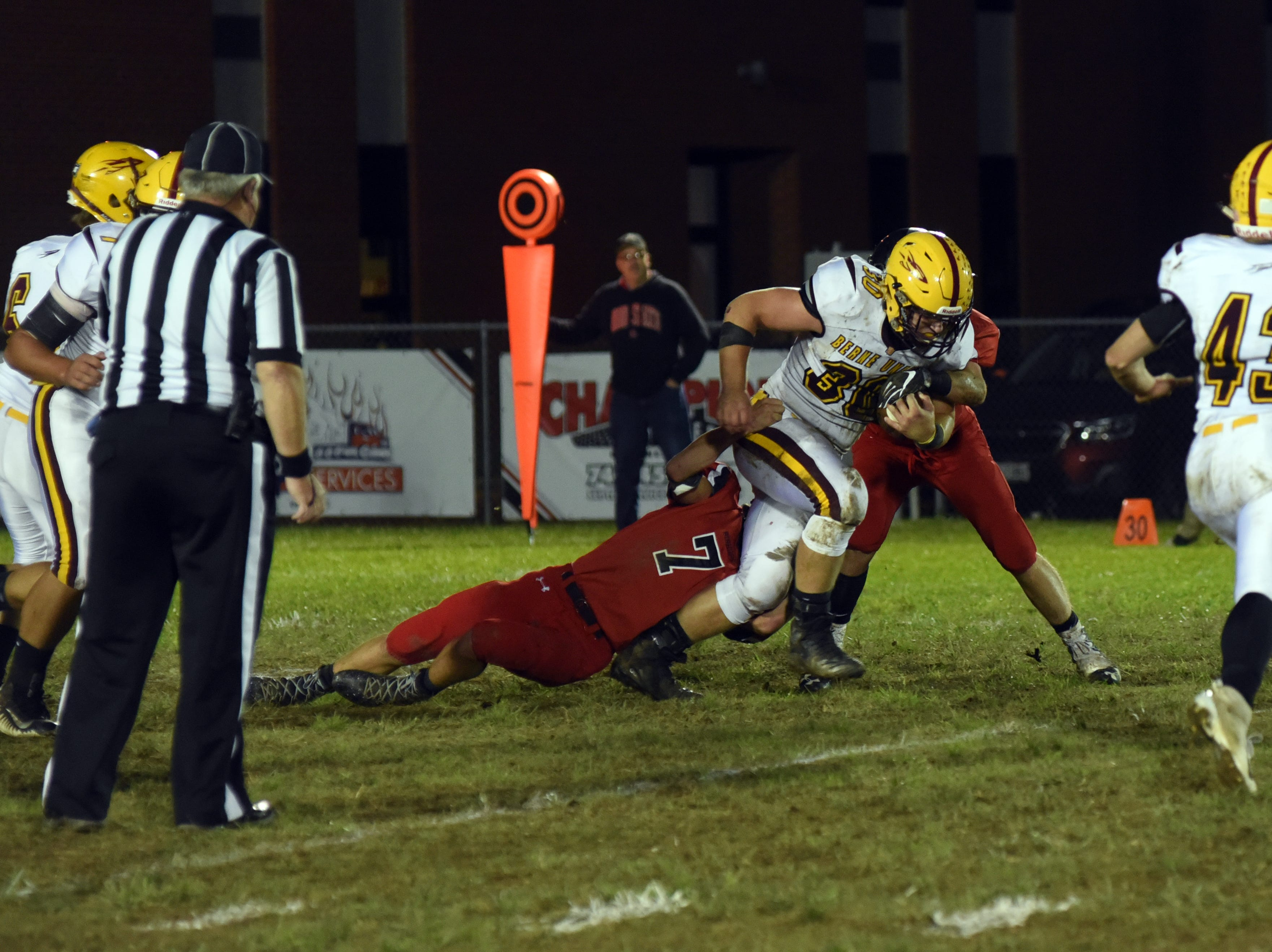 Berne Union's Chaz Dickerson fights off a Carter Dosch tackle in Berne Union's 41-14 win on Friday.