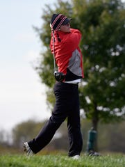 Crooksville senior Brock White tees off on the 18th hole during the first round of the Division III state golf tournament held Friday at North Star Golf Club. White shot 82 as the Ceramics sit in 10th place of 12 teams entering the final round.