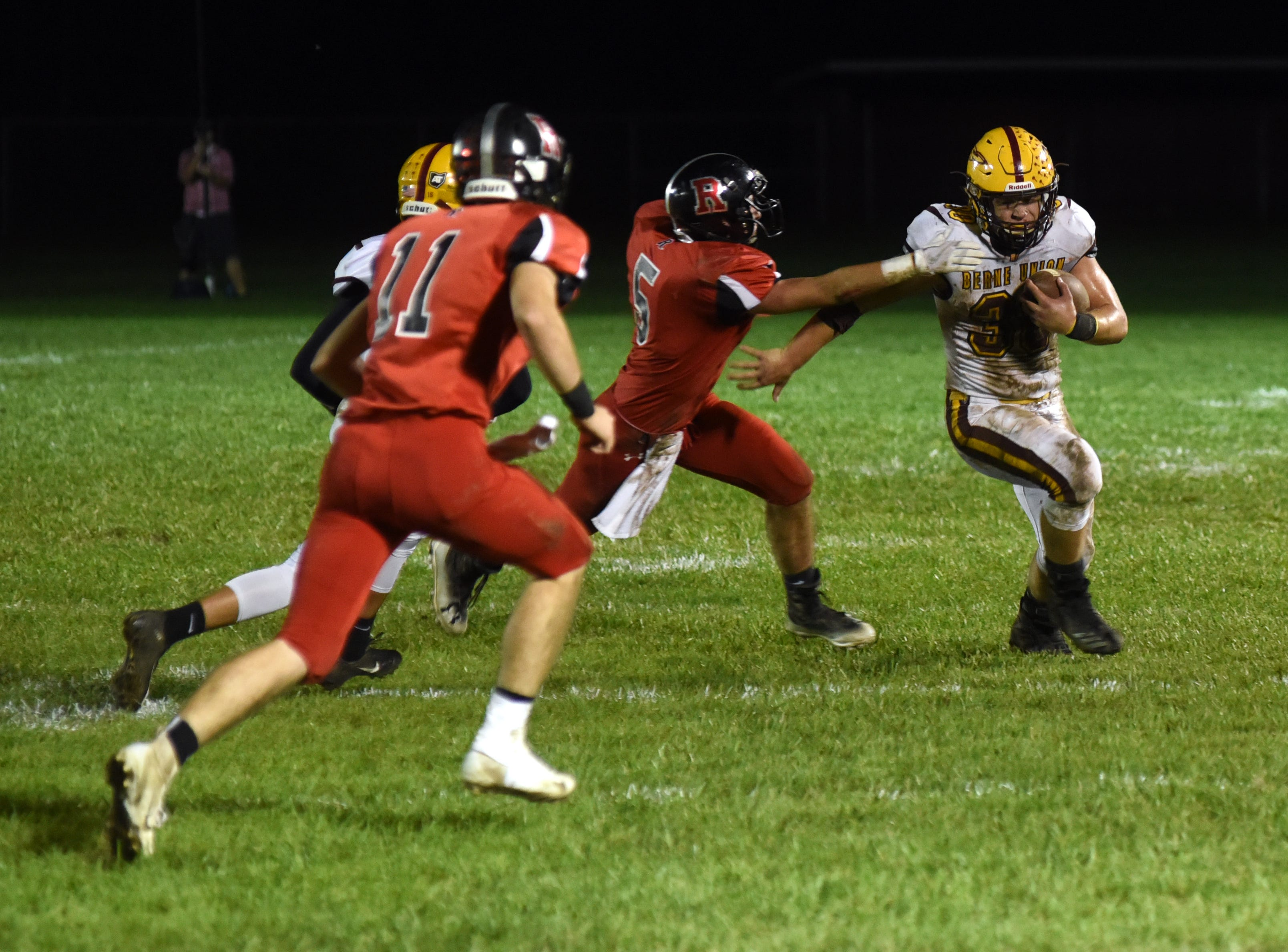 Berne Union's Chaz Dickerson tries to get past Rosecrans' Marcus Browning in Berne Union's 41-14 win on Friday.