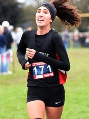 Crooksville's Savannah Moorehead runs down the backstretch during the Muskingum Valley League Cross Country Meet at Foxfire High School.