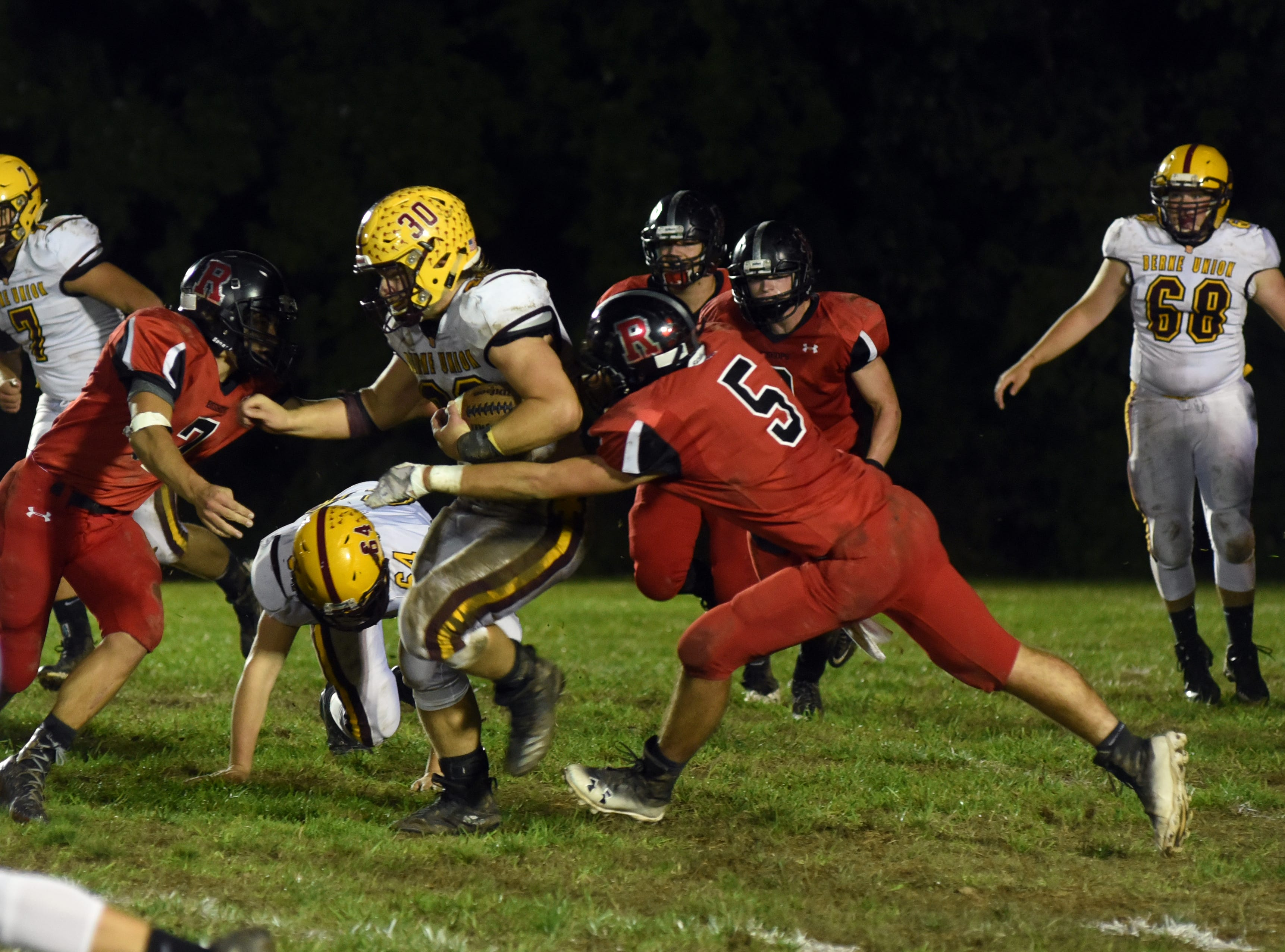 Berne Union's Chaz Dickerson runs, as Rosecrans' Marcus Browning (5) and Carter Dosch (7) try to make a tackle.