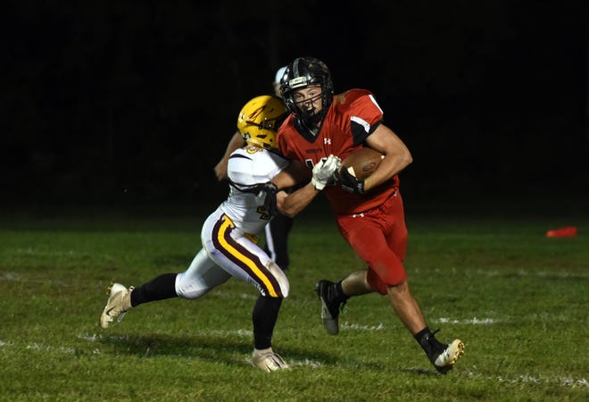 Rosecrans' Casey Biedenbach tries to fend off Berne Union's Nick Heilman during their game last season in Zanesville. Rosecrans has canceled its 2019 season due to lack of players, they announced on Monday.