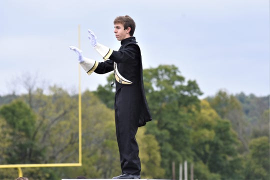 River View Drum Major Ryan Gildow, a senior, directs the band during Saturday's River View Black Bears Marching Invitational.