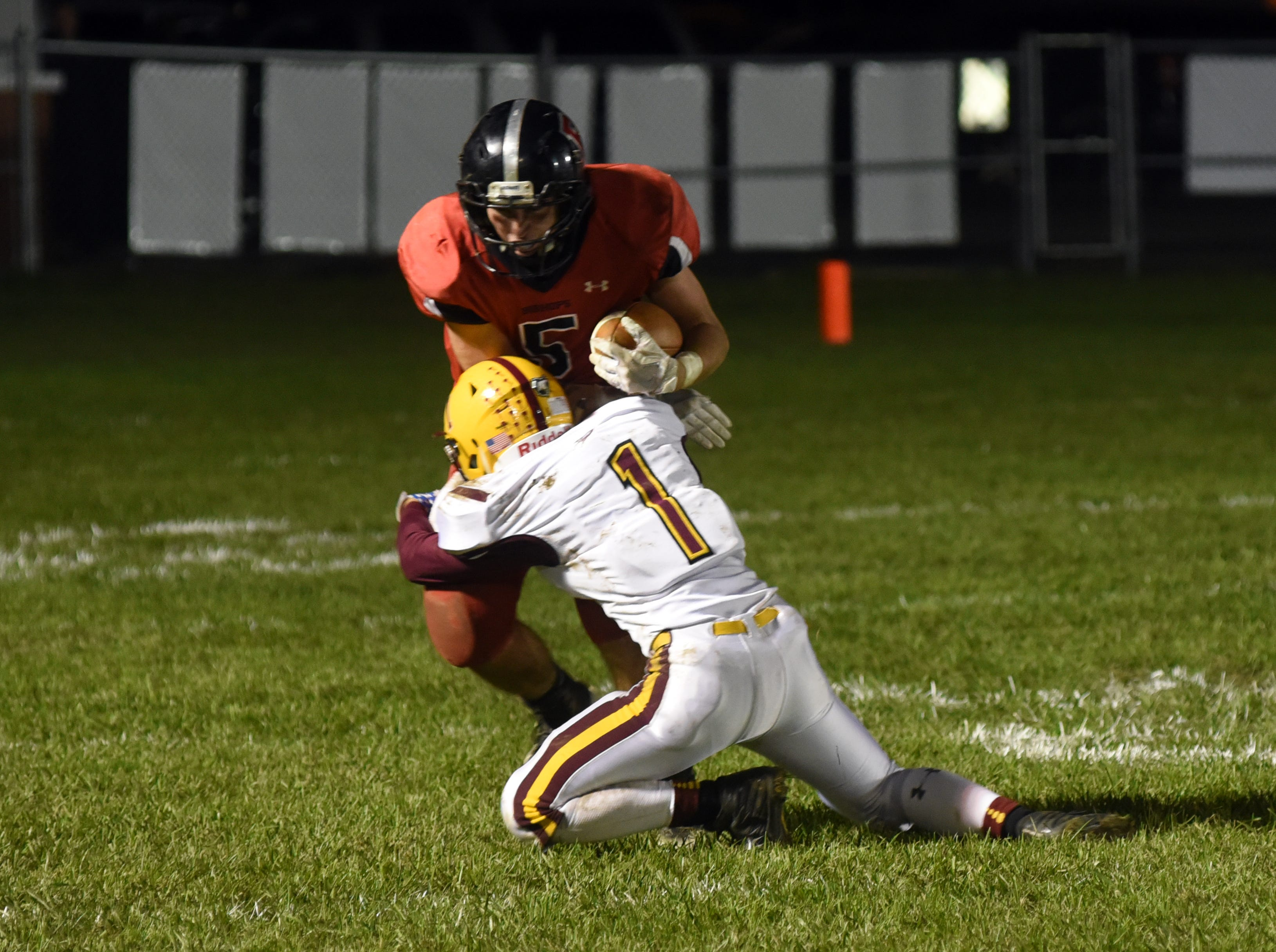 Berne Union's Wyatt Miller tackles Rosecrans' Marcus Browning in Berne Union's 41-14 win on Friday.