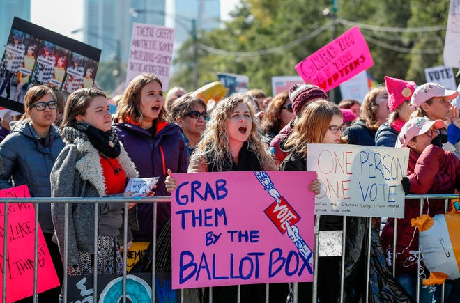 Women gather for a rally and march at Grant Park on Oct. 13, 2018 in Chicago.