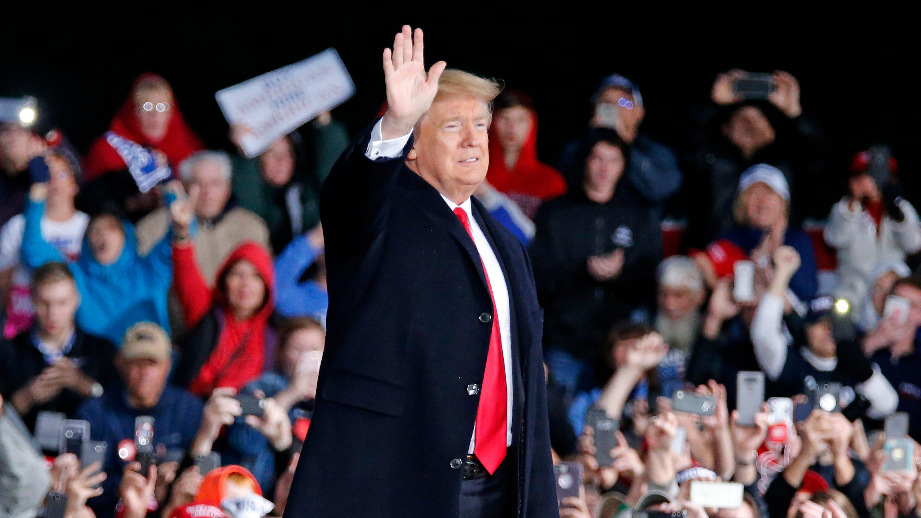 President Donald Trump takes the state as he's introduced during a Make America Great Again rally at the warren County Fair Grounds in Lebanon, Ohio, on  Oct. 12, 2018.