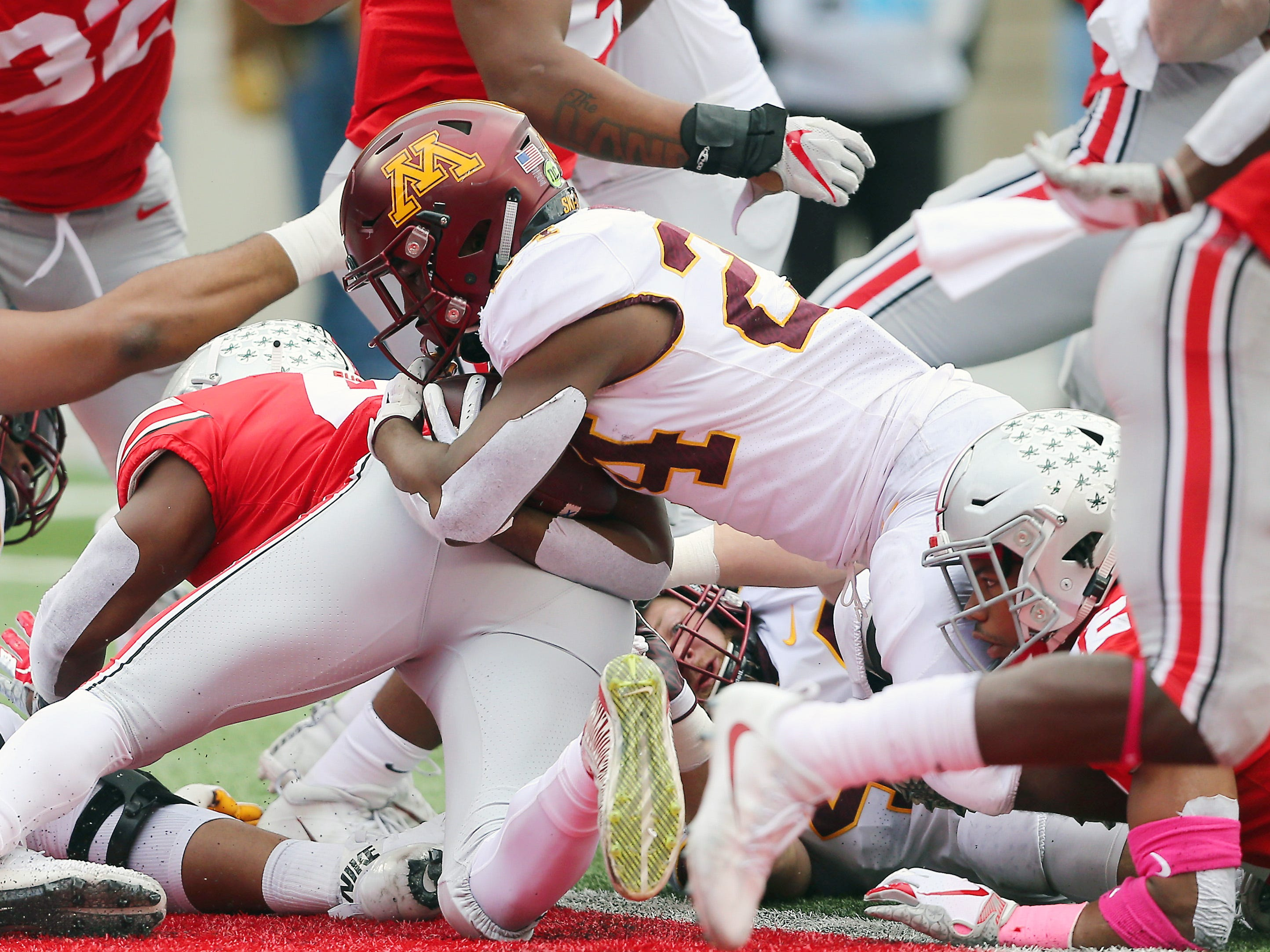 Minnesota running back Mohamed Ibrahim dives into the end zone for a   first-quarter touchdown at Ohio State.