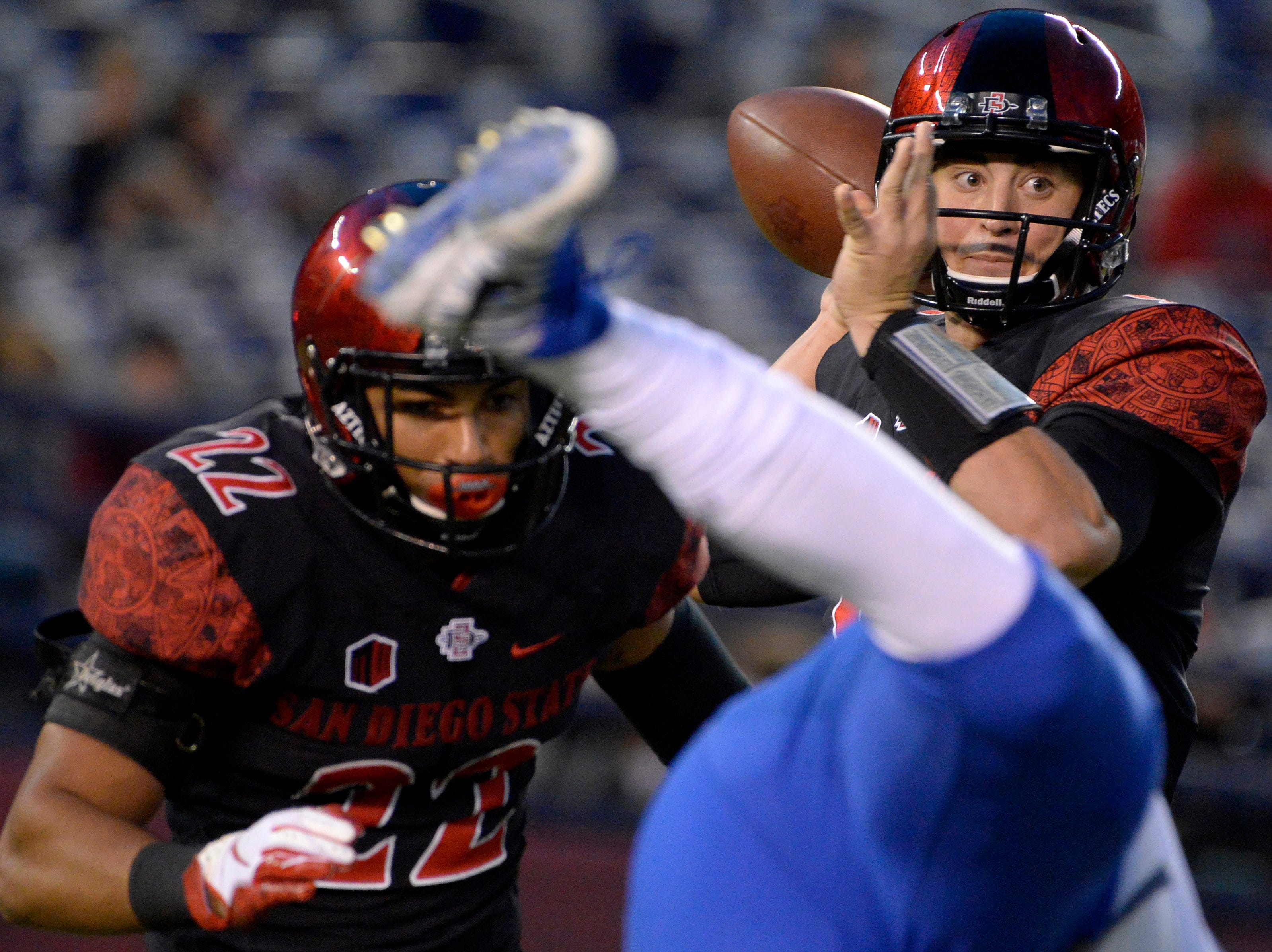 San Diego State Aztecs quarterback Ryan Agnew (right) passes during the first quarter against the Air Force Falcons at SDCCU Stadium.