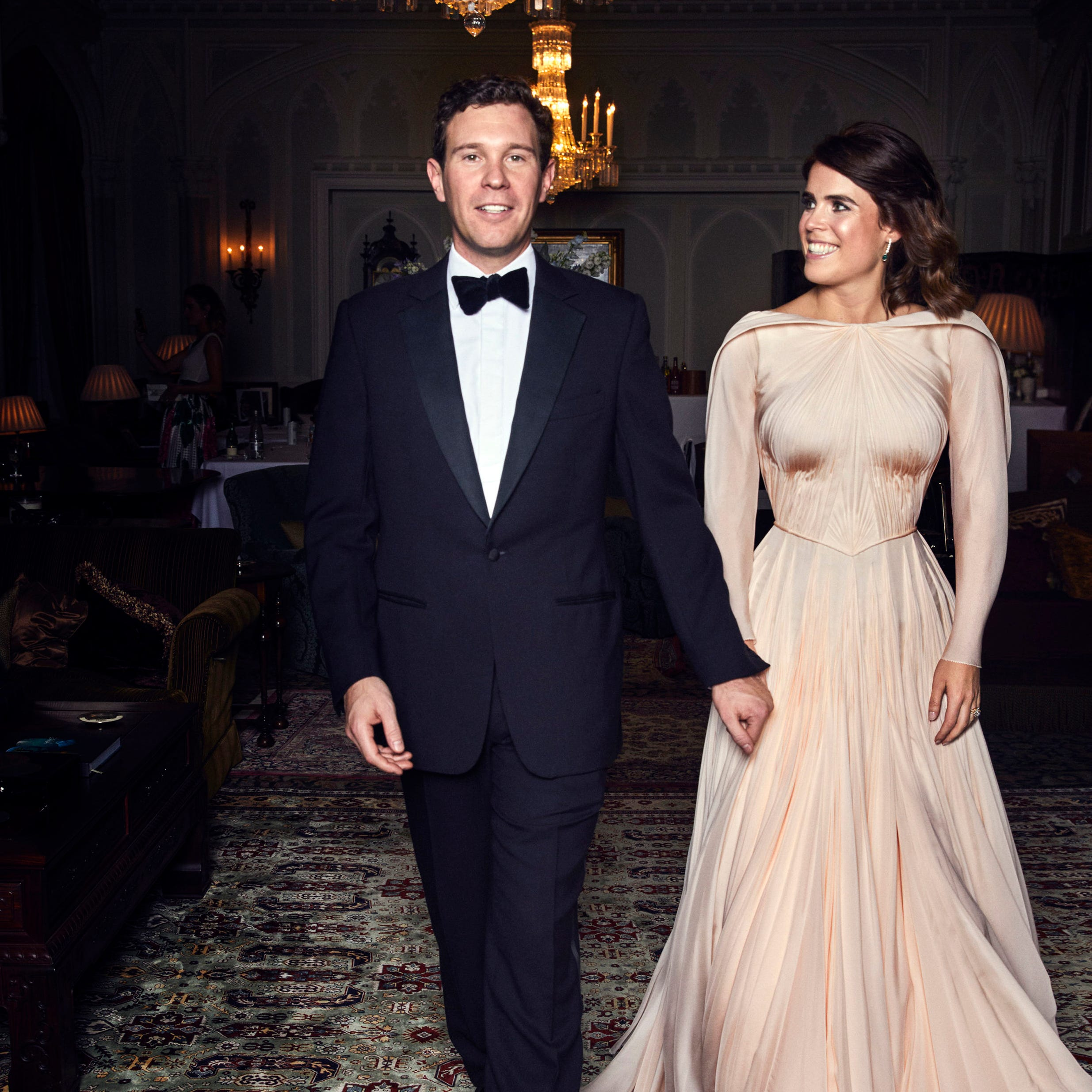 In this photo released on Saturday, Oct. 13 2018 by Buckingham Palace, Britain's Princess Eugenie of York and  Jack Brooksbank are photographed at Royal Lodge, Windsor, England, ahead of the private evening dinner, following their Wedding, at St George's Chapel, Windsor Castle on Friday, Oct. 12, 2018.