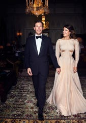 In this photo released by Buckingham Palace a day after their wedding, Princess Eugenie of York and Jack Brooksbank are photographed at Royal Lodge in Windsor, England, ahead of the couple's private evening dinner.