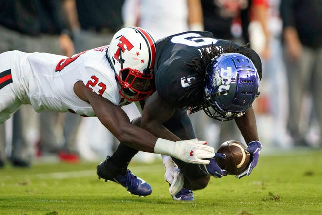 Texas Tech cornerback DaMarcus Fields (23) and the Red Raiders beat TCU 17-14 two years ago in Fort Worth for their second win in a row at Amon Carter Stadium. The Red Raiders and the Horned Frogs play again Saturday in Fort Worth.