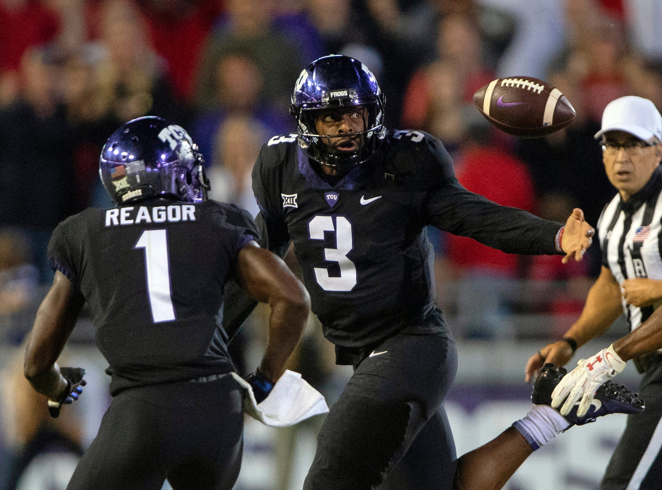 TCU Horned Frogs quarterback Shawn Robinson (3) loses control of the ball while running against the Texas Tech Red Raiders defense during the second half at Amon G. Carter Stadium.