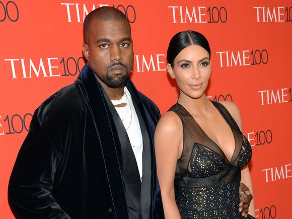 In this April 21, 2015 file photo, Kanye West and Kim Kardashian attend the TIME 100 Gala in New York.