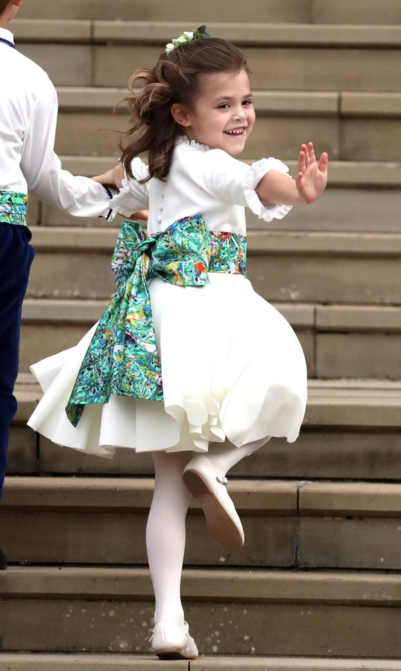 Theodora Williams waves as she arrives at the wedding of Princess Eugenie of York and Mr. Jack Brooksbank on Oct. 12, 2018 in Windsor, England.