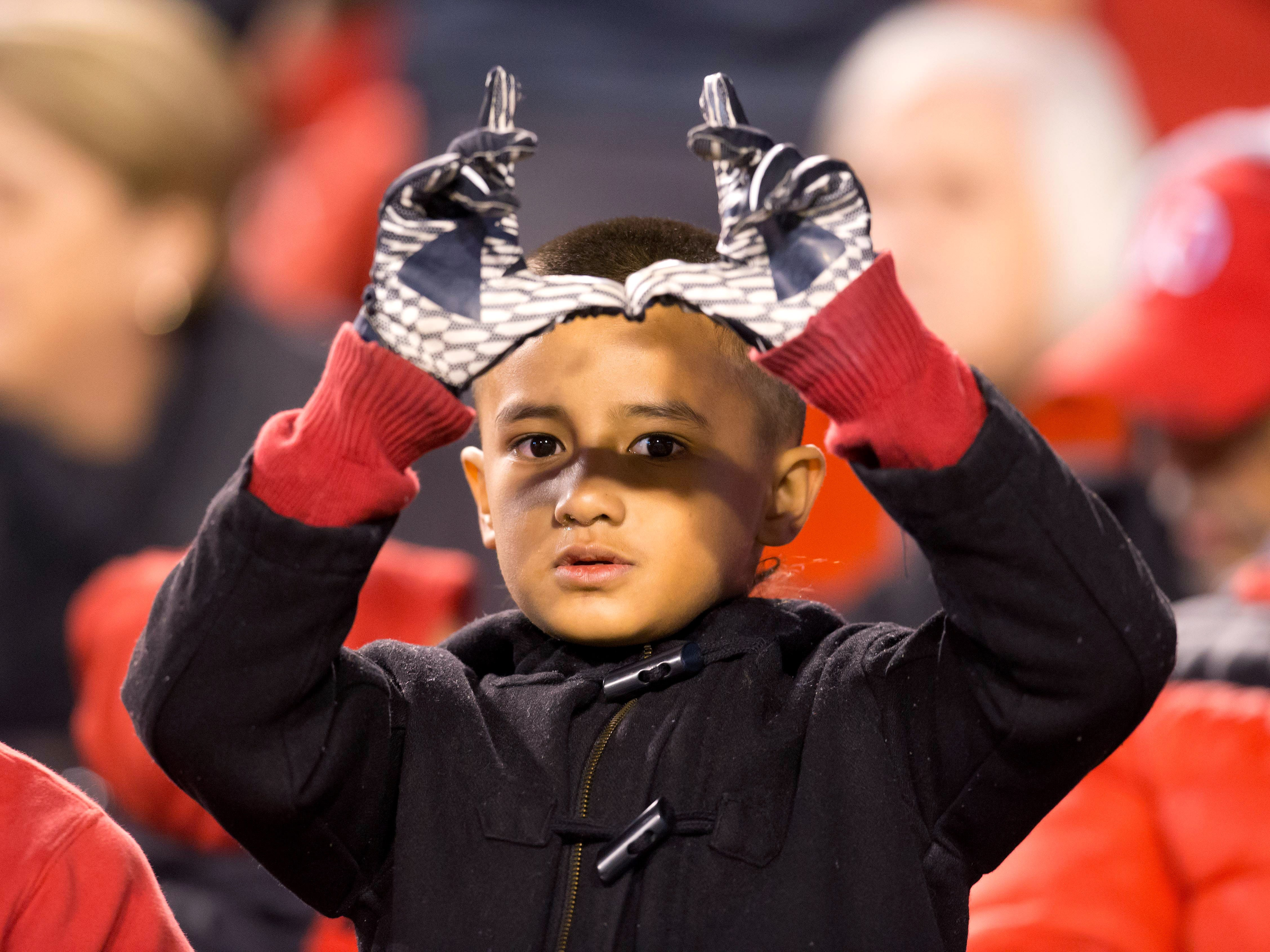 Week 7: A Utah Utes fan flashes a U from the stands during the first half against the Arizona Wildcats at Rice-Eccles Stadium.