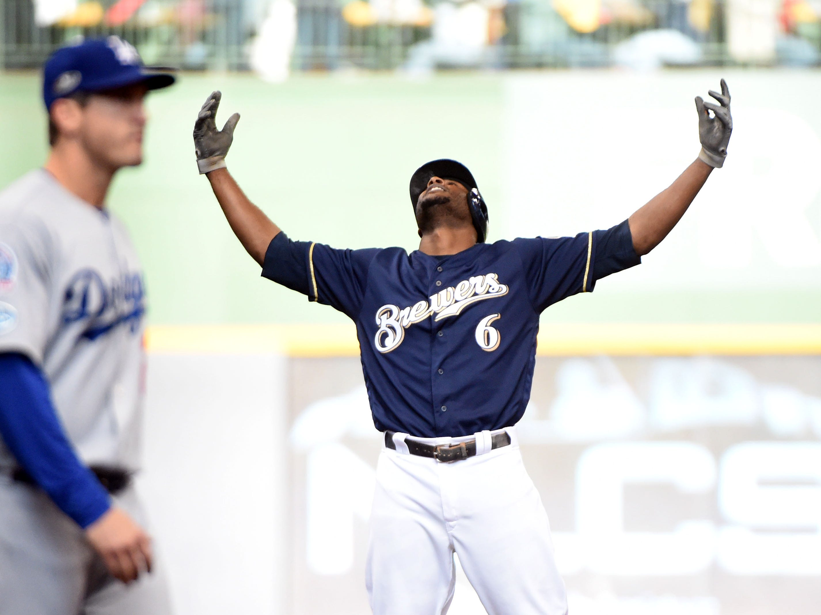 NLCS Game 2: Brewers center fielder Lorenzo Cain reacts after hitting a double in the fifth inning.