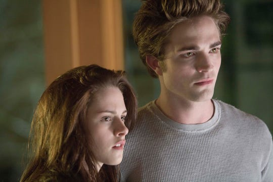 "Kristen Stewart (as Bella Swan) and Robert Pattinson (Edward Cullen) starred as the couple at the heart of ""Twilight."""