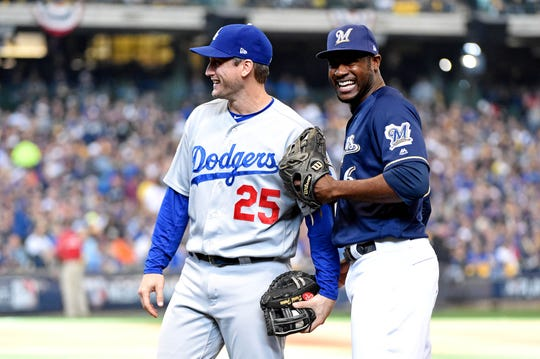 NLDS Game 2: Brewers center fielder Lorenzo Cain jokes with Dodgers first baseman David Freese, who he robbed of a home run in the first inning.