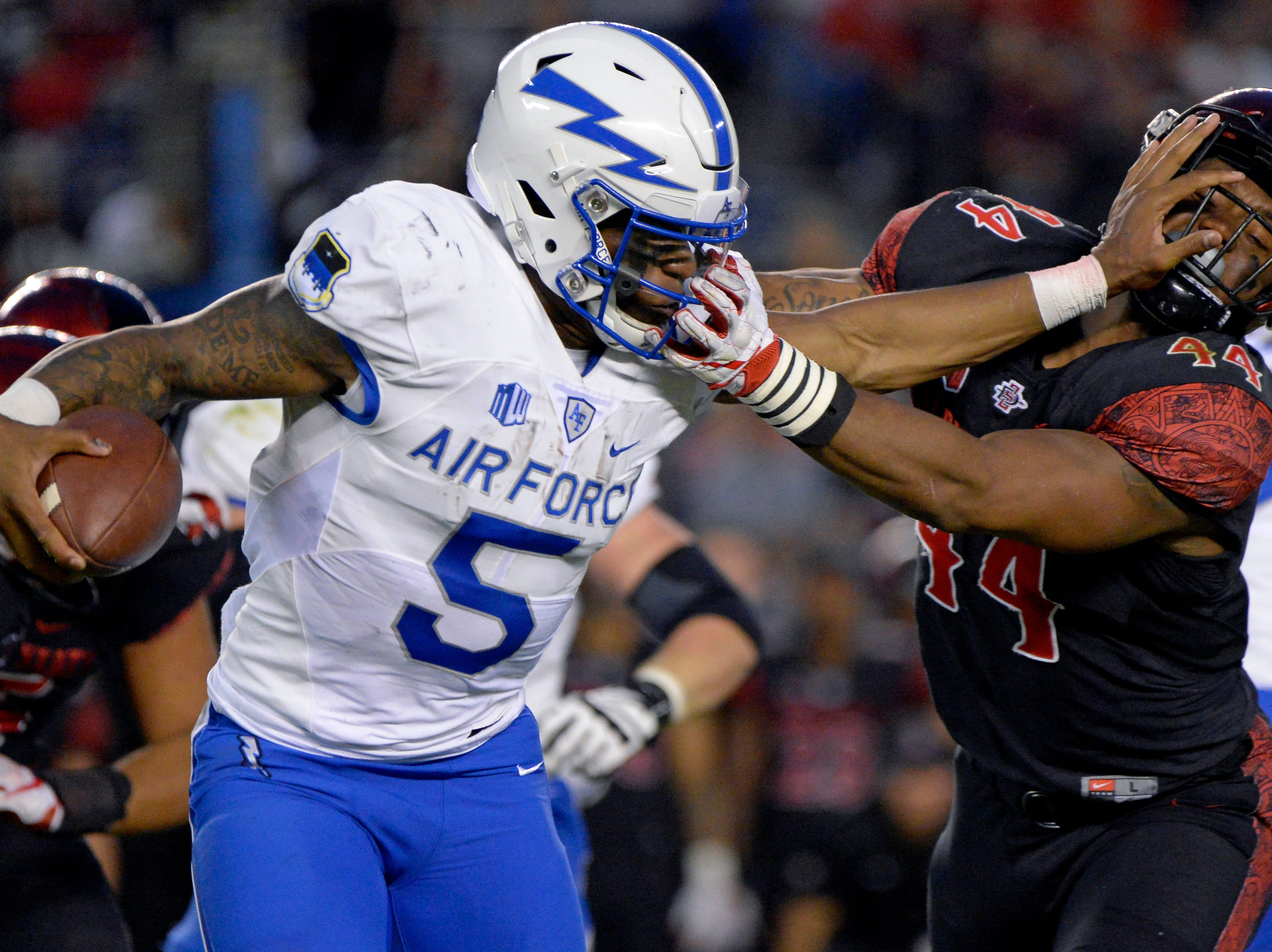 Air Force Falcons quarterback Donald Hammond III (5) runs the ball as San Diego State Aztecs linebacker Kyahva Tezino (44) defends during the first quarter at SDCCU Stadium.