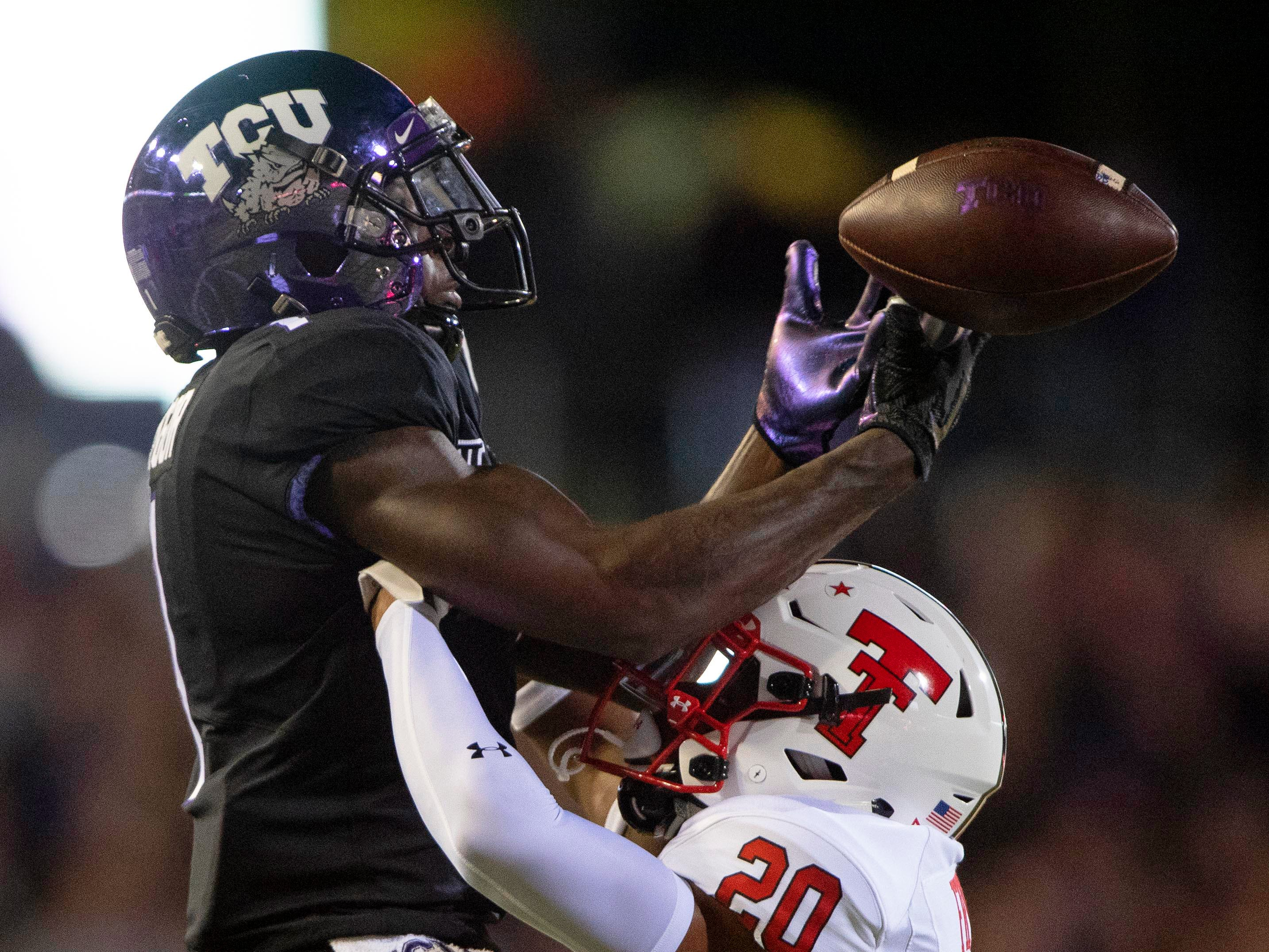 Texas Tech Red Raiders defensive back Adrian Frye (20) defends against TCU Horned Frogs wide receiver Jalen Reagor (1) during the second half at Amon G. Carter Stadium.