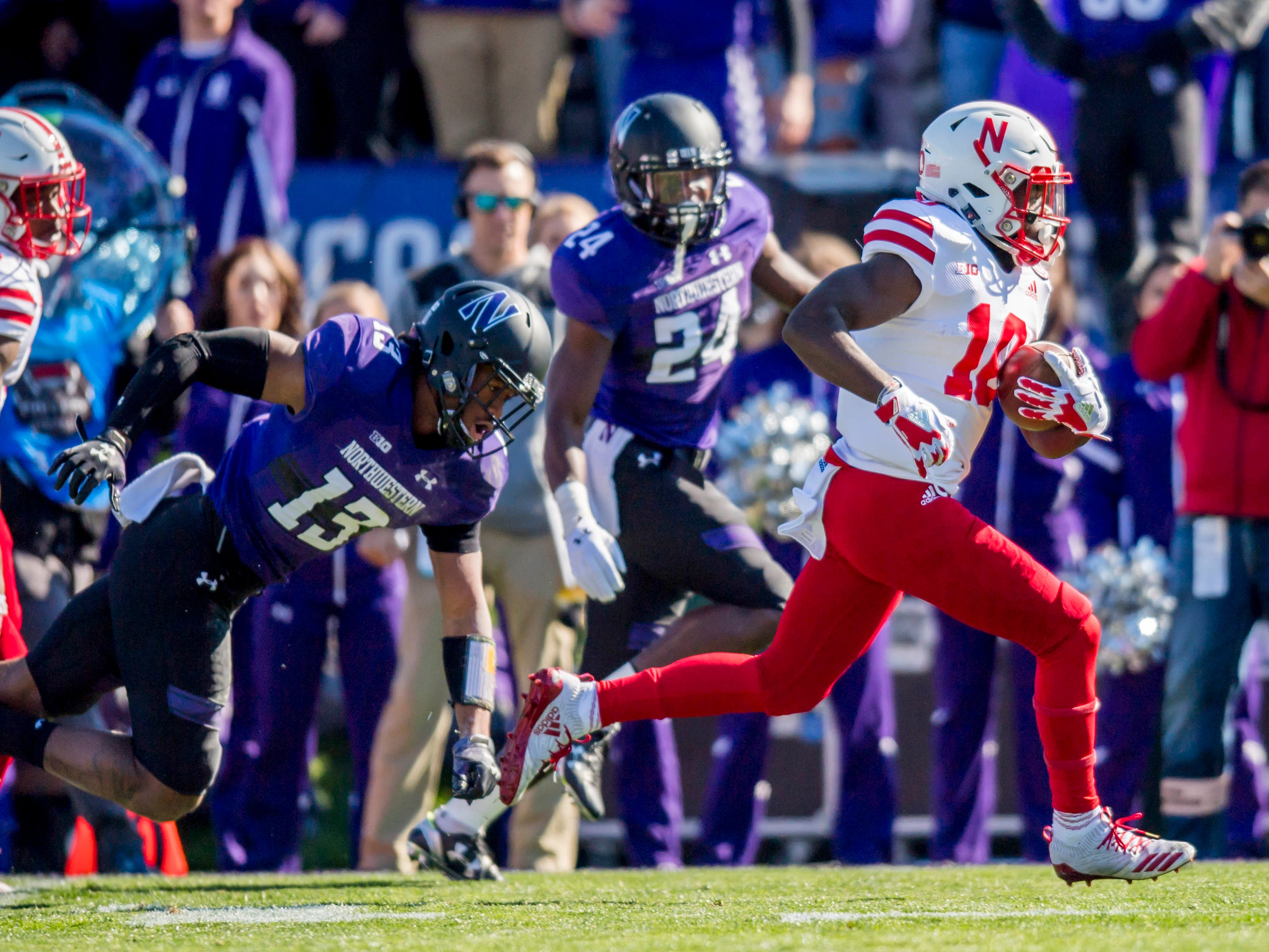 Nebraska wide receiver JD Spielman breaks free from the Northwestern defense to score a touchdown in the first half.