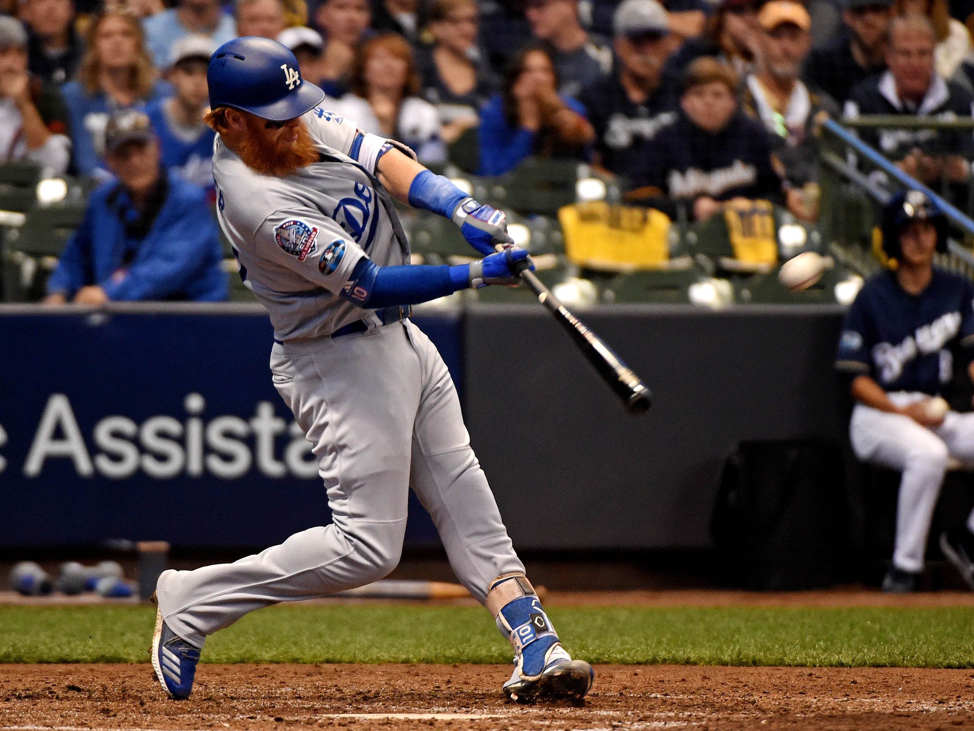 NLCS Game 2: Dodgers third baseman Justin Turner slugs a go-ahead two-run home run in the eighth inning.