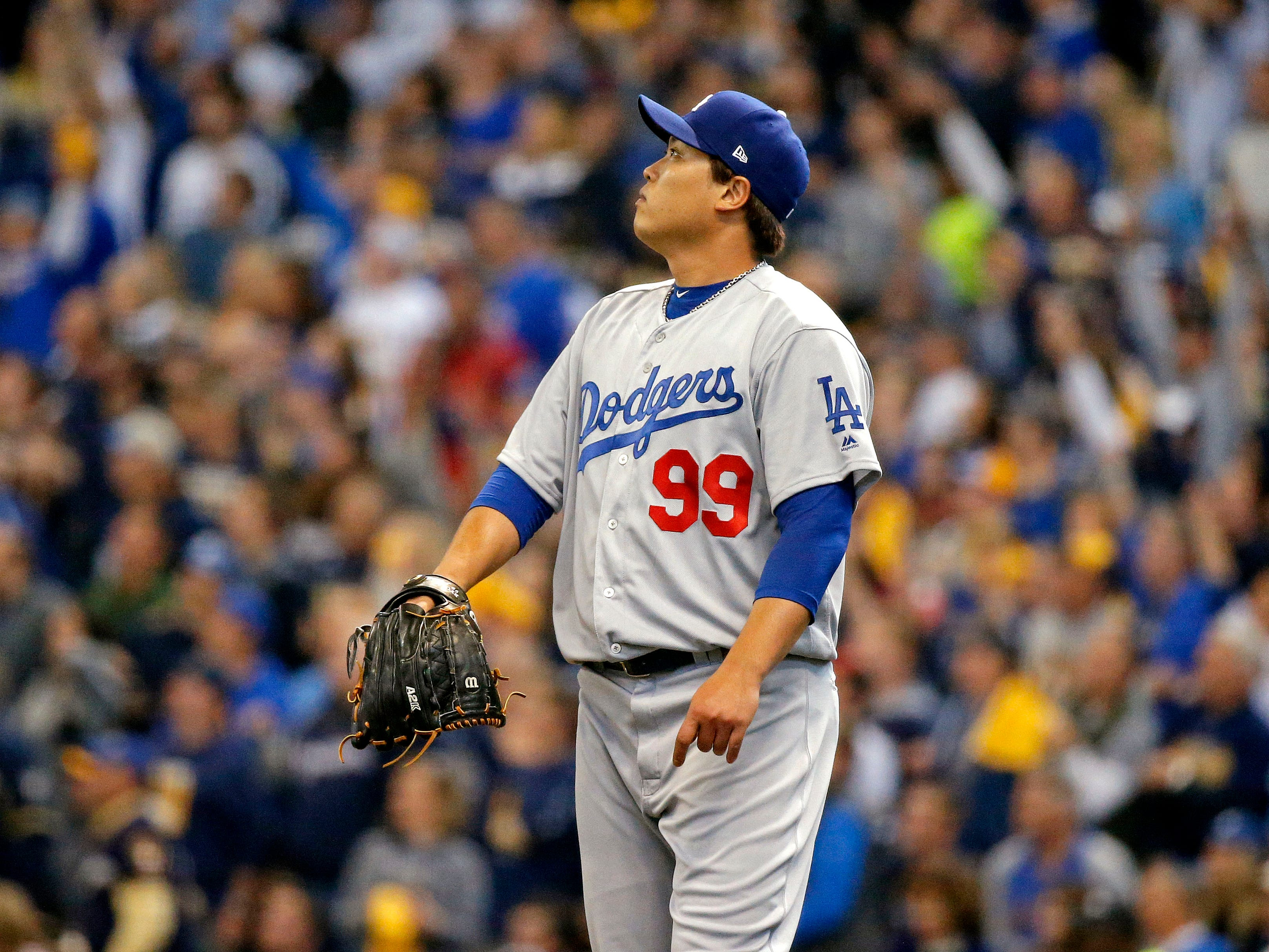 NLCS Game 2: Dodgers starting pitcher Hyun-Jin Ryu watches a home run hit by Brewers shortstop Orlando Arcia in the fifth inning.
