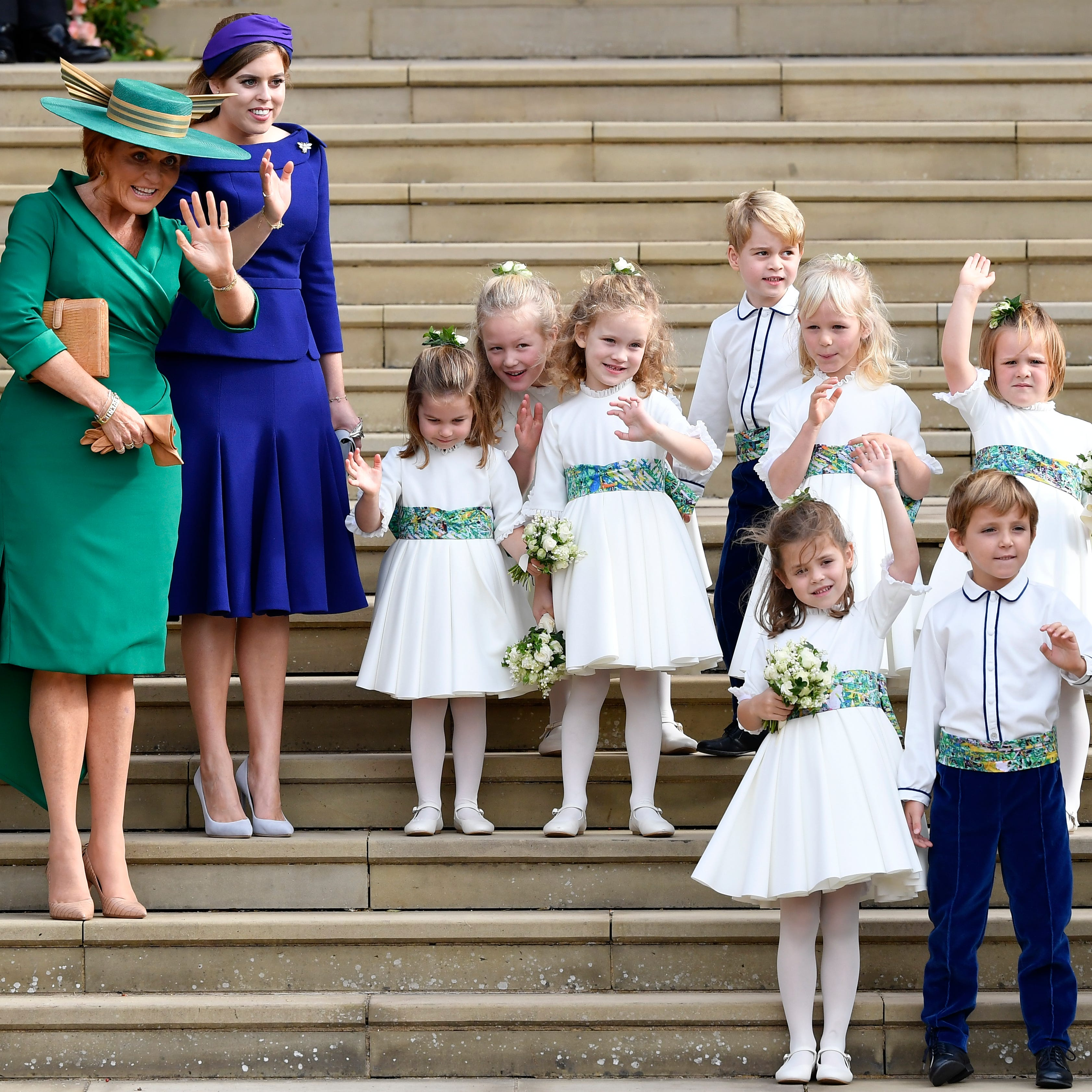 Sarah Ferguson and Princess Beatrice, the bridesmaids and page boys, wave after the wedding of Princess Eugenie of York and Jack Brooksbank on Oct. 12, 2018.