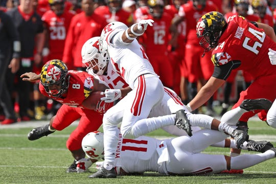 Maryland running back Tayon Fleet-Davis gets tackled by a group of Rutgers defenders during the first half at Capital One Field at Maryland Stadium.