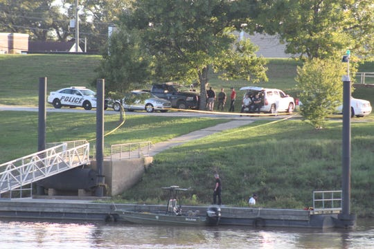 Law enforcement gathered at an area on the Red River in downtown Alexandria Sunday afternoon as the search for a woman who possibly attempted suicide continues. The search was to end at dark and begin again Monday morning.