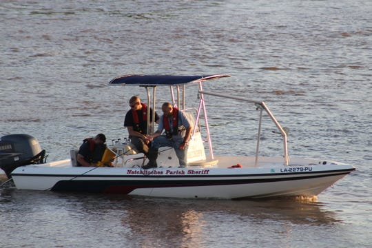 Searchers from the Natchitoches Parish Sheriff's Office help in the hunt for a woman who might have attempted suicide Sunday on the Red River.
