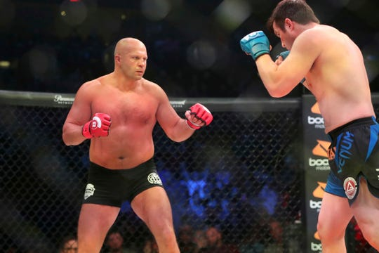 Fedor Emelianenko, left, pursues Chael Sonnen during a mixed martial arts bout at Bellator 208, in Uniondale, NY on Saturday, Oct. 13, 2018. Emelianenko won via first round TKO. (AP Photo/Gregory Payan)