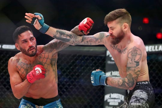 Henry Corrales, left, exchanges blows Andy Main during a mixed martial arts bout at Bellator 208, in Uniondale, NY on Saturday, Oct. 13, 2018. Corrales won via third round TKO. (AP Photo/Gregory Payan)