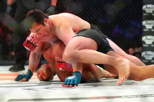 Chael Sonnen, top, grapples with Fedor Emelianenko during a mixed martial arts bout at Bellator 208, in Uniondale, NY on Saturday, Oct. 13, 2018. Emelianenko won via first round TKO. (AP Photo/Gregory Payan)