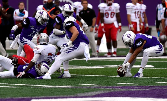 Abilene Christian linebacker Jeremiah Chambers recovers the ball fumbled by Nicholls' wide receiver Damian Jeanpiere, jr. during Saturday's game at ACU Oct. 13, 2108. Final score was 28-12, ACU.