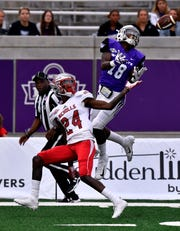 Abilene Christian wide receiver Torin Justice goes up to receive a pass while being covered by Nicholls' defensive back Darren Evans during Saturday's game at ACU Oct. 13, 2018. Final score was 28-12, ACU.