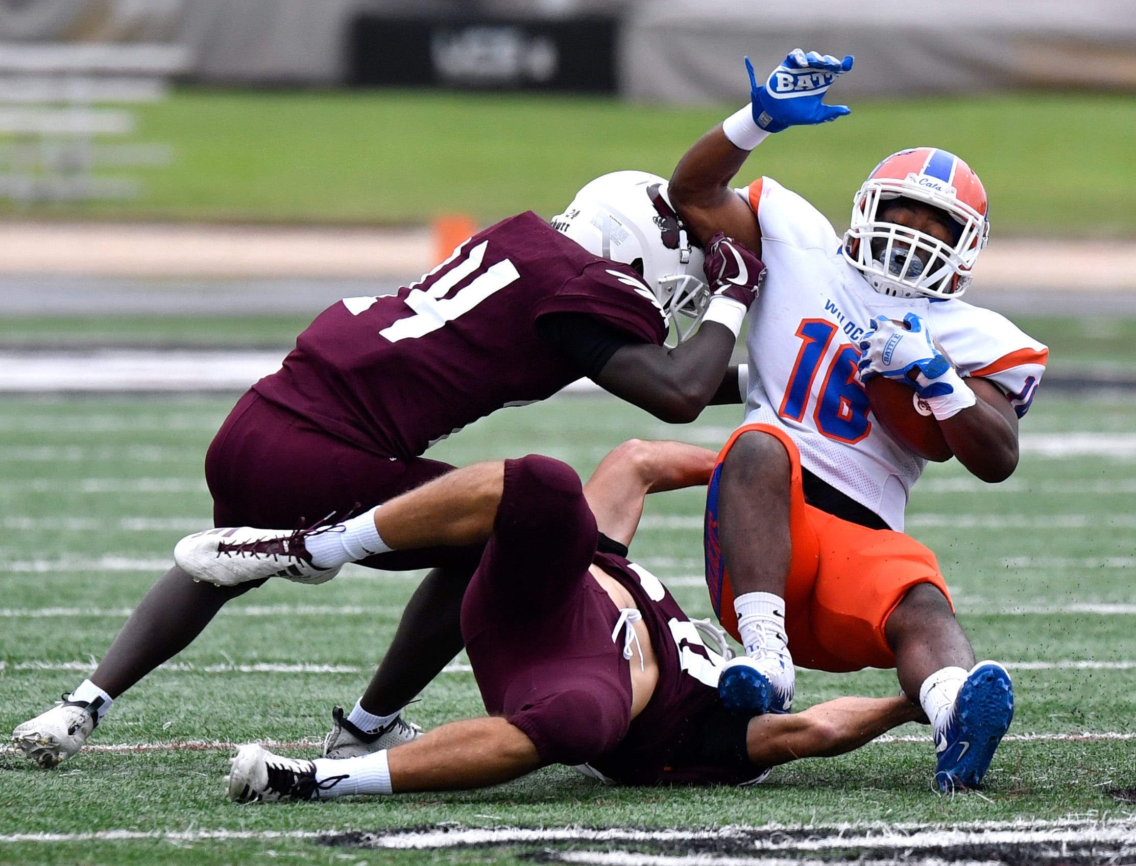 McMurry defensive backs Edward Coleman, jr. (left) and Reagan Miller tackle Louisiana College's running back Melvin Young III Saturday Oct. 13, 2018. Final score was 35-23, Louisiana.