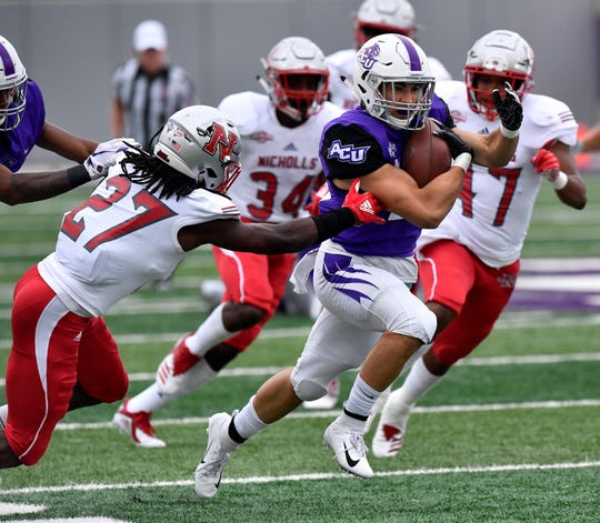 ACU running back Billy McCrary sprints downfield during the Wildcats' game against Nicholls. ACU won the Southland Conference game 28-12 at Wildcat Stadium.