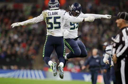 Seattle Seahawks defensive end Frank Clark (55) celebrates with defensive end Branden Jackson (93) after Clark sacked Oakland Raiders quarterback Derek Carr.