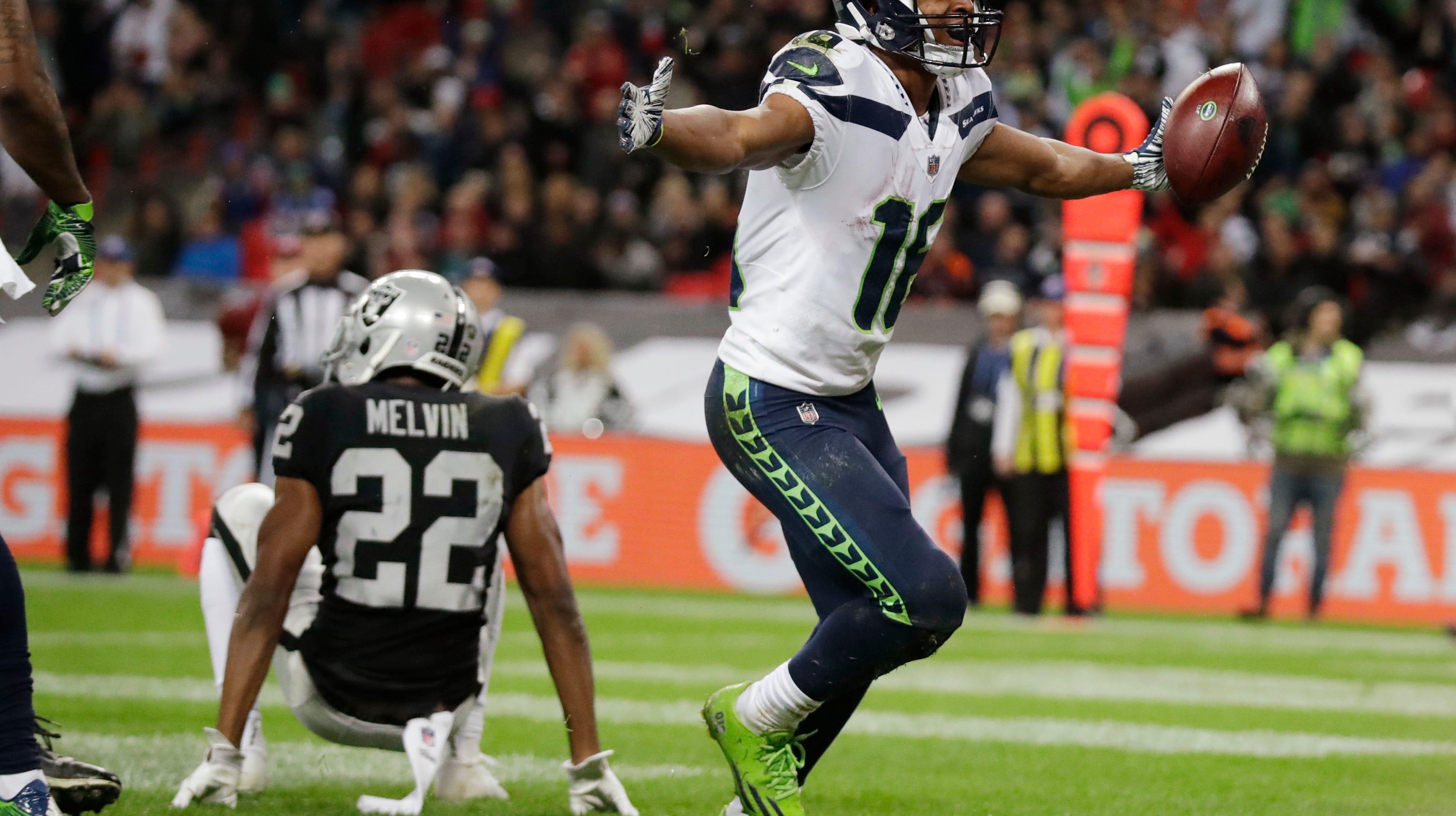 Seattle Seahawks wide receiver Tyler Lockett (16) celebrates after scoring a second-half touchdown.