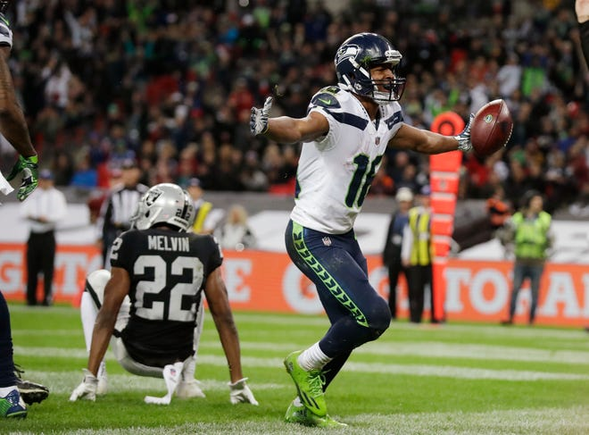 Seattle Seahawks wide receiver Tyler Lockett (16) celebrates after scoring a second-half touchdown.