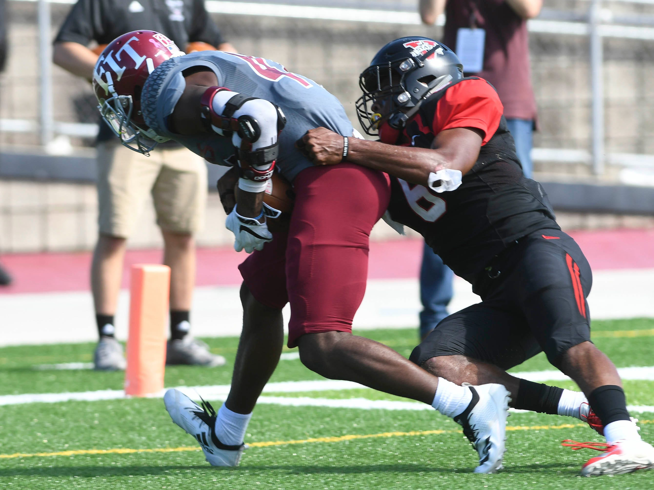 Damien McGhee of Florida Tech drags Ravarius Rivers of Valdosta State into the end zone during Saturday's game.
